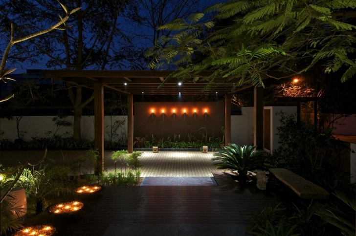 Entrance to the Courtyard Home by Hiren Patel Architects at night