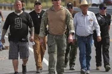 Scofflaw rancher Cliven Bundy surrounded by armed supporters at his Arizona ranch.