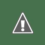 Un paysan consolidant son grenier à mil