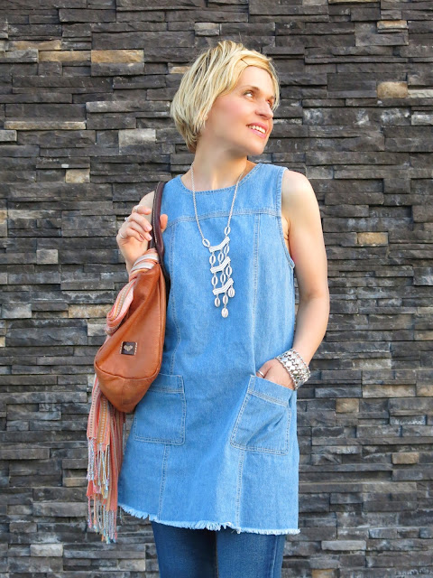 a denim shift dress, flare jeans, and accessories