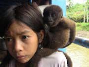The girl looks sad here, but she was proud of her animal and normaly her . (girl with monkey)