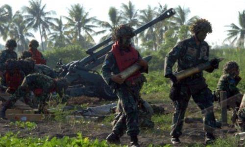 Persiapan amunisi Howitzer 105