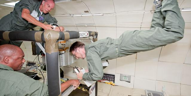 Pictured left: Dr. Frank Little, top, and Dr. Rube Williams, left, weightless on a recent zero-gravity flight. Credit: SERC