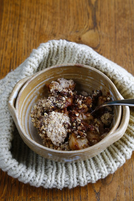 A bowl full of a pear and chocolate crumble