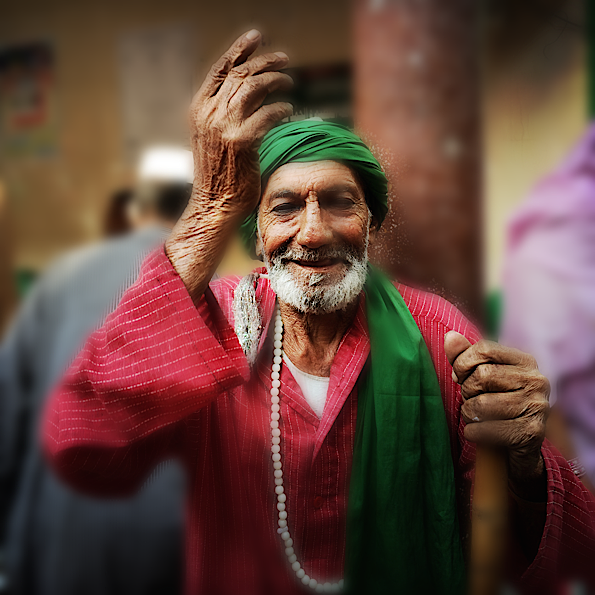 Happy Guy at Sufi Temple © Connie Gardner Rosenthal