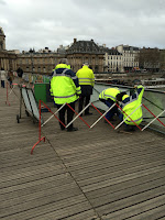 french workers repair lock damaged bridge 2
