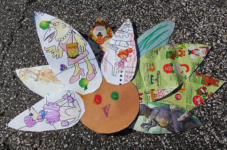 Make a turkey from recycled papers, cards, and magazines.