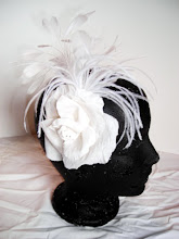 silk rose with beaded centre and feather spray