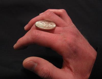 coin roll, rolar moeda dedos