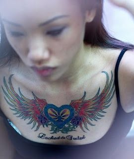 Tattooed Girl Chest Tattoo - Heart with Wings Tattoo Design