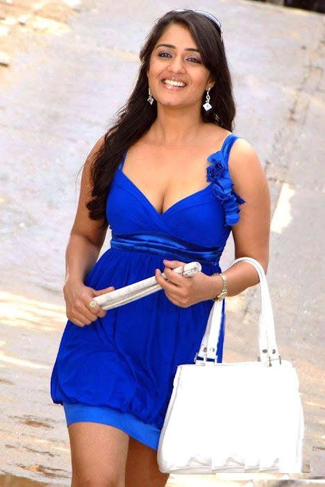 Nikitha in Blue Short Skirt Dress showing her thighs carrying a Handbag