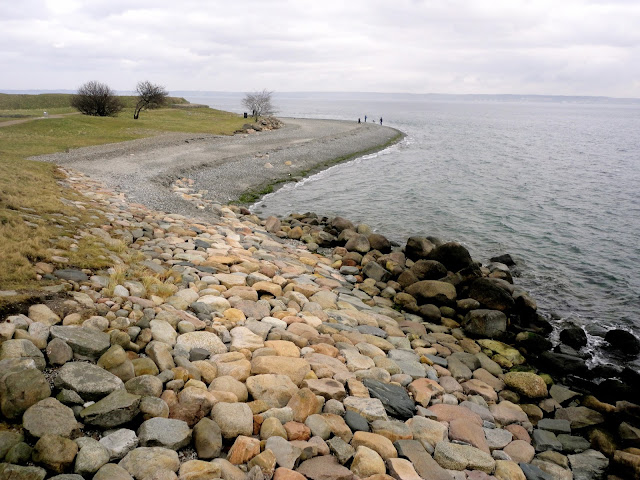 Coastal views and pebble beach beside Kronborg Castle, Helsingor, Copenhagen, Denmark