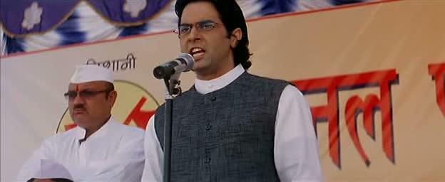 Aman Verma as Minister Srivastav giving a speech