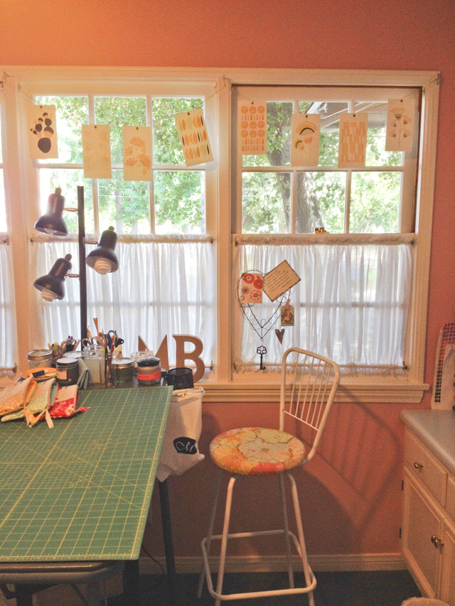 collection of mood board cards strung as hanging pennant in a window