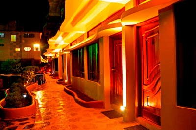 Galapagos Eco Lodge lit at night by wind driven ecological power source