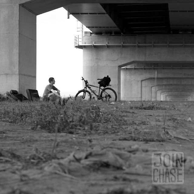 Resting under a highway bridge along the Geum River Bike Path in South Korea.