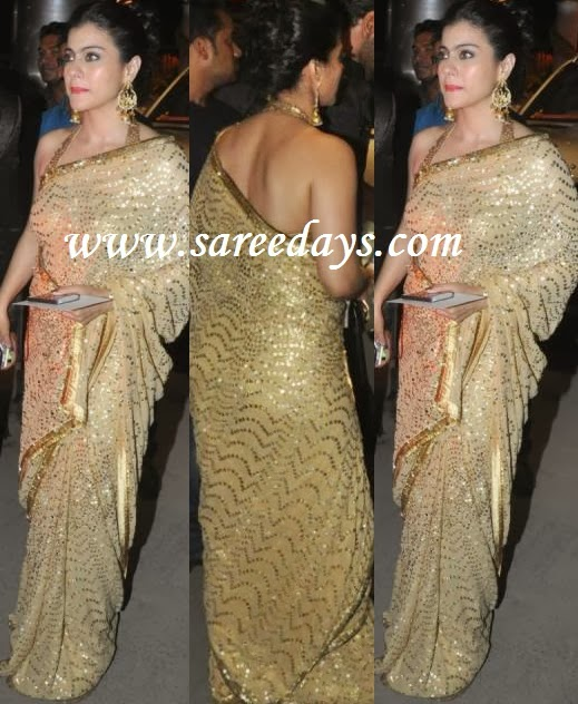 Latest saree designs kajol in gold colour work designer saree bollywood actress kajol in gold colour work designer saree with rich work and satin border and paired with halter neck matching blouse altavistaventures Image collections