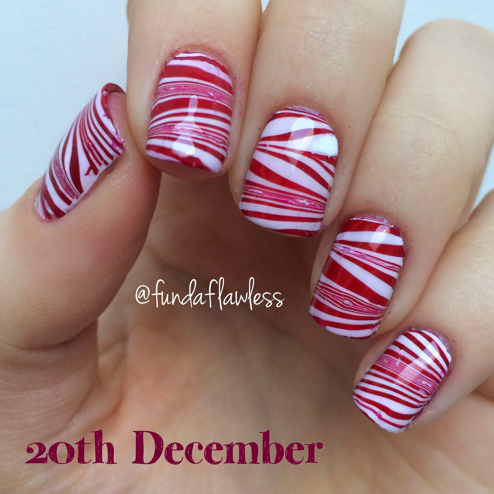 Candy Cane Watermarble Nail Art with Models Own White Light and Brunette Red