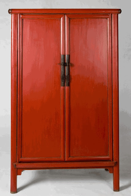 Orange asian armoire from the Silk Road Connection