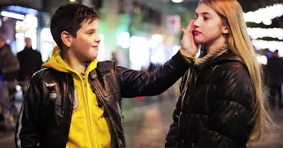 Screen cap of the video where the young boys were asked to caress the girl
