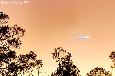 Cigar-Shaped UFO Disappeared in White Cloud