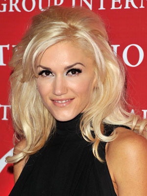 Gwen Stefani shows off her mod side with a half-up hairstyle that boasts ample volume and softness.