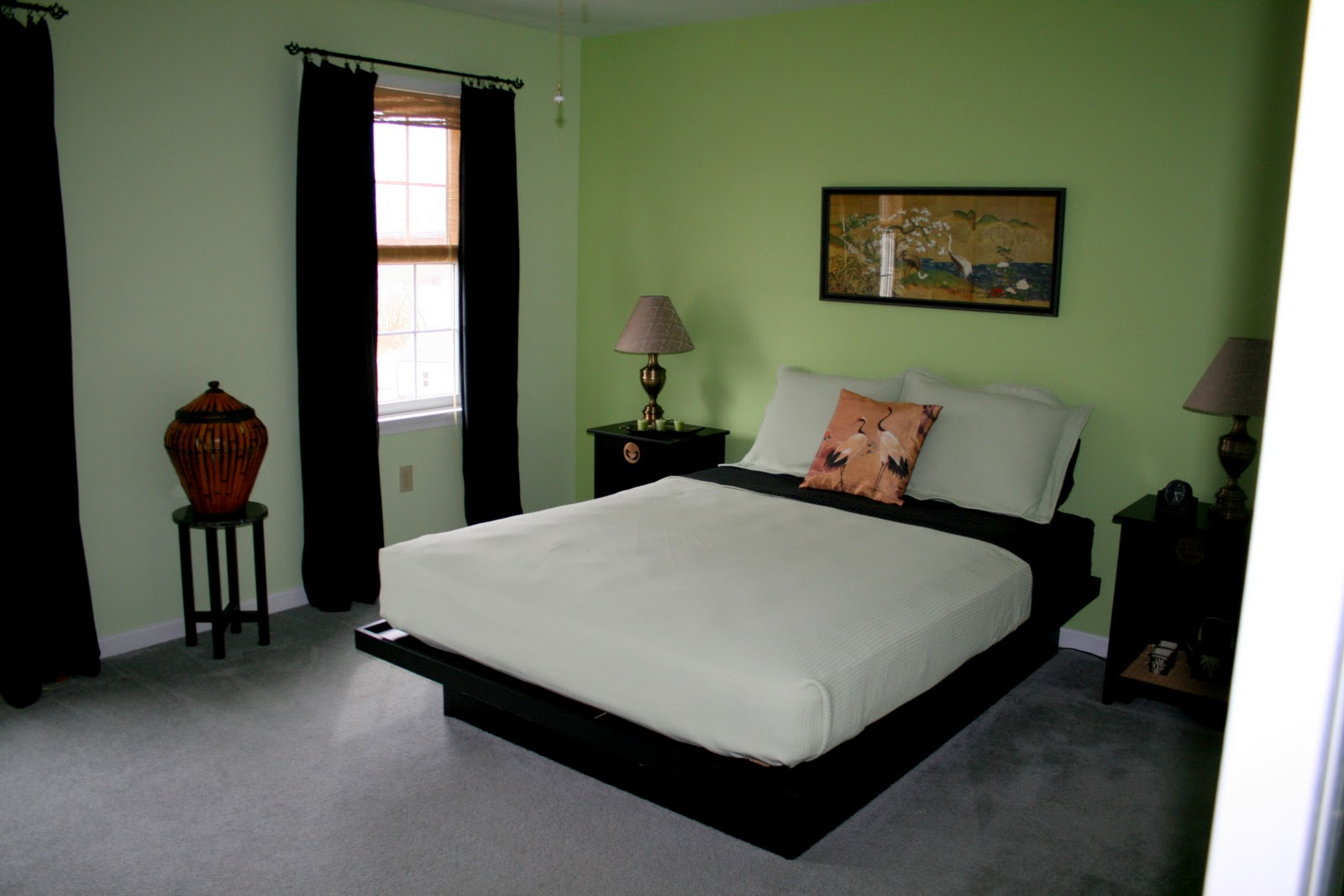 green bedroom walls with black furniture
