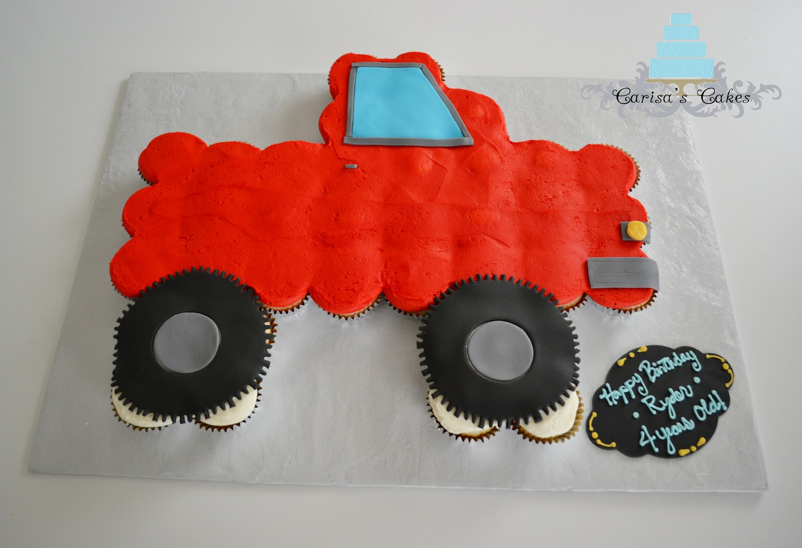 A Car Shaped Cake Made With Cupcakes