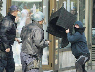 funny pictures hooligan with a chair and cop with a pistol