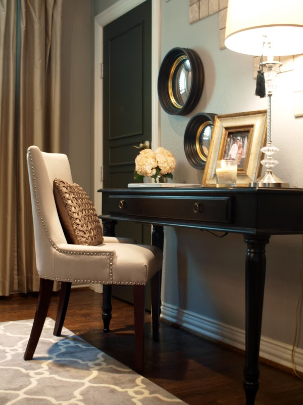 A Black Door Sets The Stage For This Pretty Vignette At A