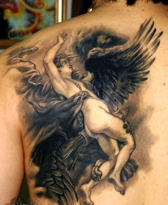 fighting angel tattoo design on the back