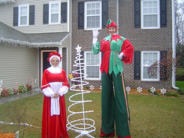 Company Christmas Party Entertainment Ideas Part - 41: Stilt Elf And Mrs Claus