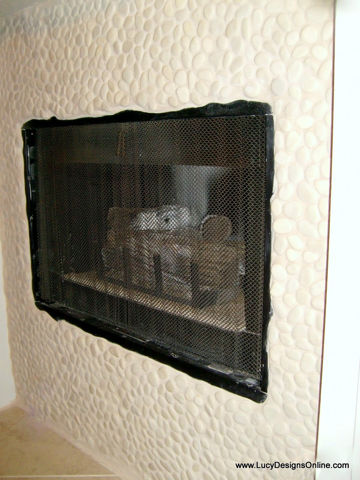 pebble mosaic fireplace surround