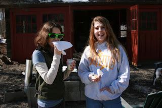 Girls eating cookies.
