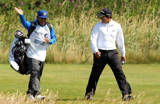 Carlos Tévez walks alongside Andrés Romero during the 2012 British Open Golf Championship