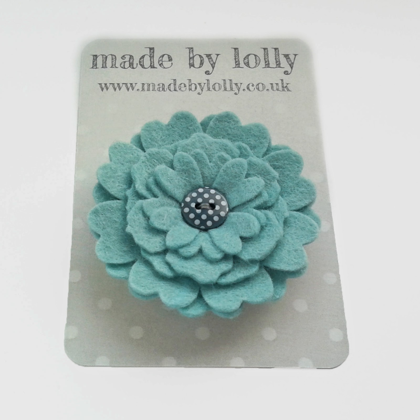 http://madebylolly.co.uk/ourshop/prod_3118782-HANA-Felt-Flower-Brooch-Aqua.html