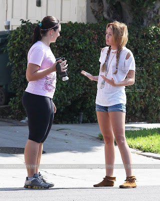 American Actress Miley Cyrus With Her Friend