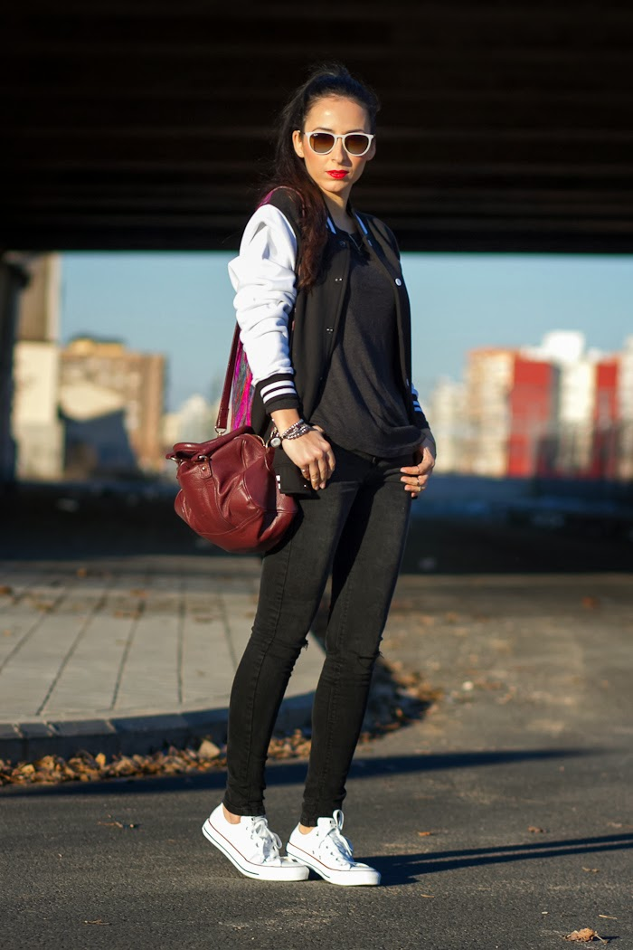 Streetstyle with black and white Varsity Jacket and white Leather Converse Trainers