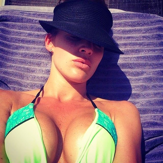 """Danielle Lloyd uploads this pictures during sunbathing session at her home, Surrey England on Saturday, May 20, 2014 and wrote: """"to all my follower."""""""
