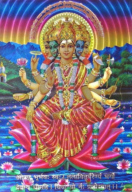 """Gayatri Devi the Goddess Gayatri Devi the Goddess is considered the veda mata, Essentially, the Goddess is seen to combine all the phenomenal attributes of Brahman. Goddess Gayatri is also worshipped as the Hindu Trimurti. Some also consider her to be the mother of all Gods and the culmination of Lakshmi, Parvati and Sarasvati.   About Gayatri Mantra  What is a Gayatri mantra, It is a jewel among the treasures that is handed down from generation to generation. To be initiated into this sacred mantra is a great privilege. The sound or even the thought of the Gayatri's verse sets grace in action. Those who are called by her are initiated into her power by the Master.  The Gayatri Mantra is first recorded in the Rig Veda (iii, 62, 10) which was written in Sanskrit about 2500 to 3500 years ago, and by some reports, the mantra may have been chanted for many generations before that. Gayatri Mantra is a highly revered mantra in Hinduism, second only to the mantra Om. Since all the other three Vedas contain much material rearranged from the Rig Veda, the Gayatri mantra is found in all the four Vedas. The deva invoked in this mantra is Savitr, and hence the mantra is also called Savitri.  Gayatri is typically portrayed as seated on a red lotus, signifying wealth. She appears in either of these forms:  1. Having five heads with the ten eyes looking in the eight directions plus the earth and sky, and ten arms holding all the weapons of Vishnu, symbolizing all her reincarnations.  2. Accompanied by a white swan, holding a book to portray knowledge in one hand and a cure in the other, as the goddess of Education.    """"Aum Bhoor Bhuwah Swaha, Tat Savitur Varenyam, Bhargo Devasaya Dheemahi, Dhiyo Yo Naha Prachodayat"""""""