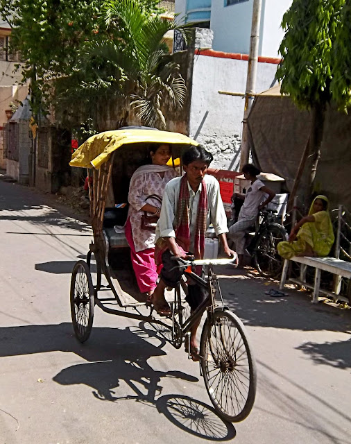 kolkata cycle ricksaw with passenger