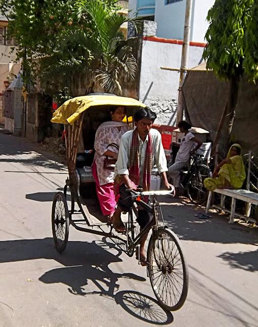 kolkata cycle ricksaw with passenger