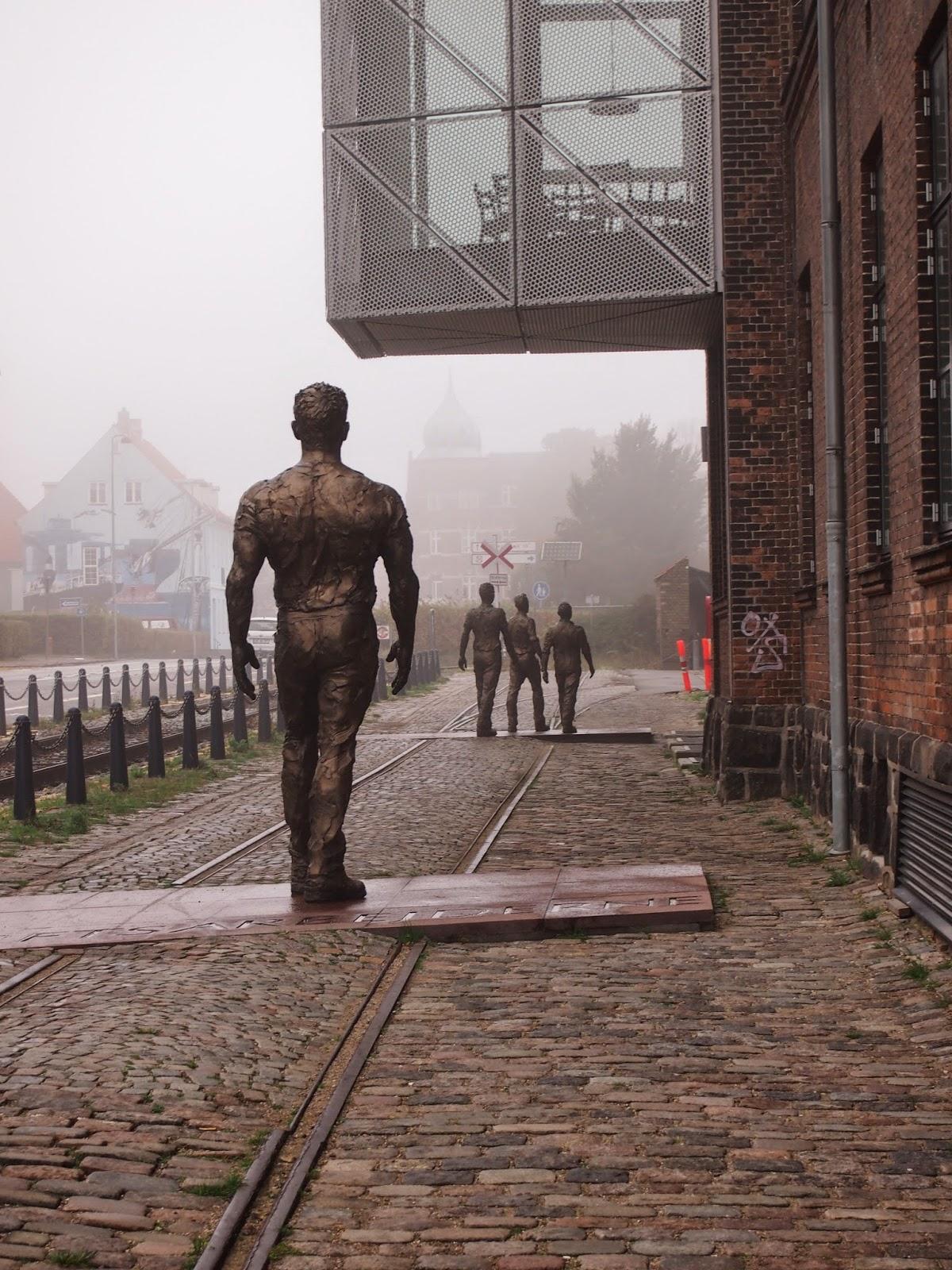 walking men statues in the culture yard in Helsingor