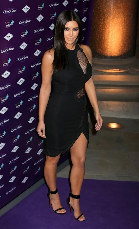 Kim Kardashian on purple red carpet