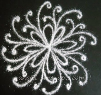 A simple kolam with floral patterns and curlicues for Apartment kolam design