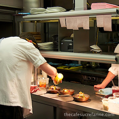 A photo of chefs preparing meals at Nopi Restaurant in London, England.