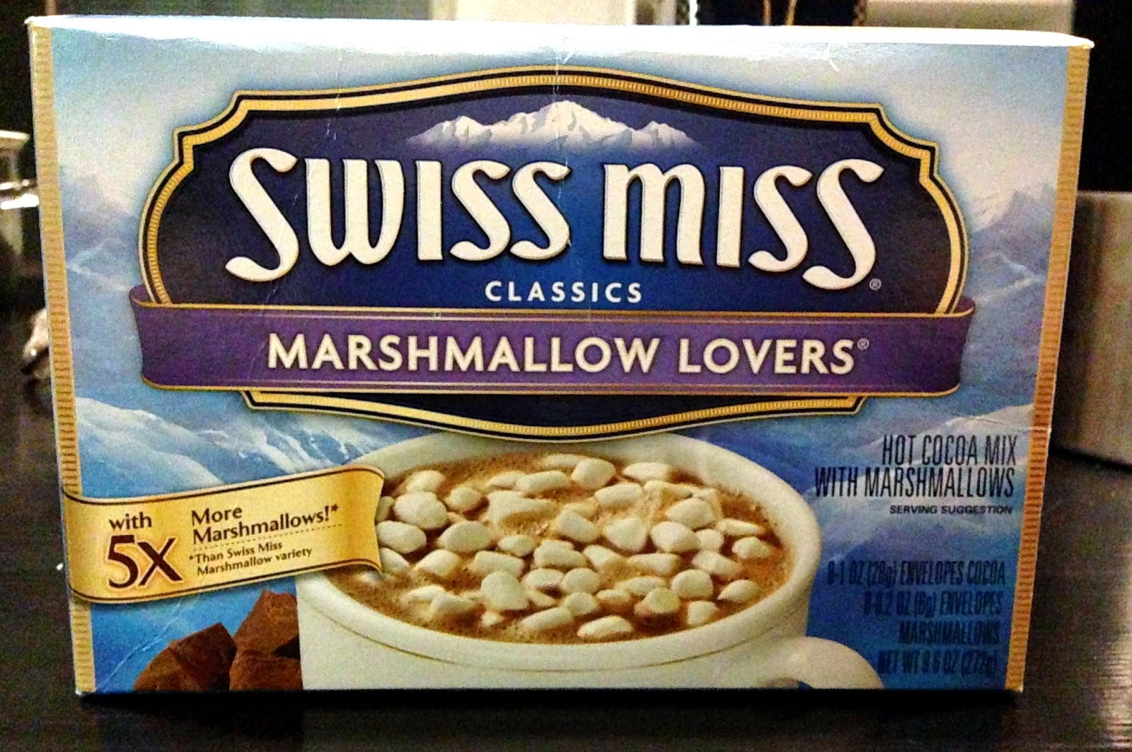 a picture of a swiss miss hot chocolate marshmallows more