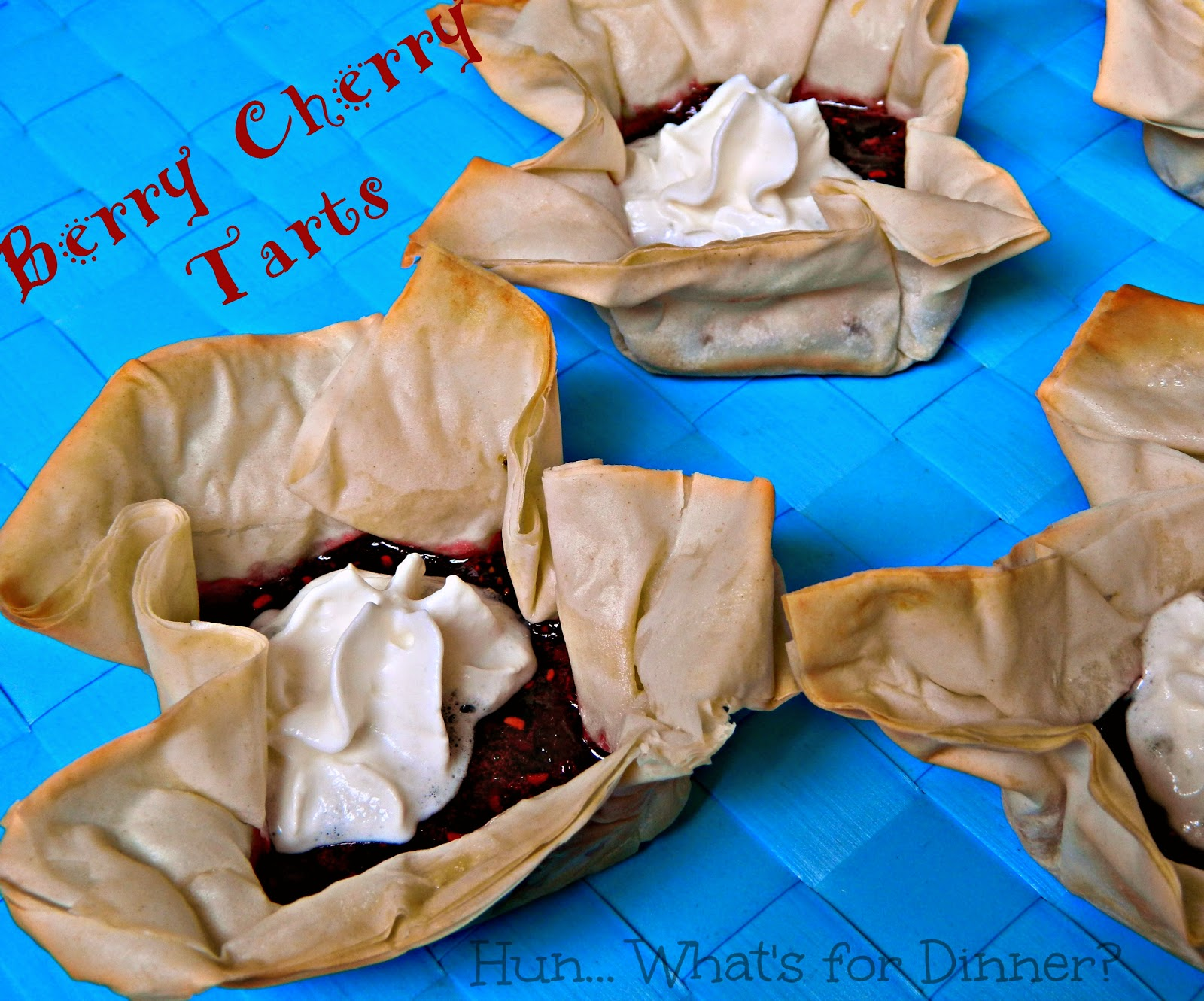 Berry Cherry Tarts- Crisp phyllo cups are filled with a delicious summer berry and fresh cherry filling, and finished off with real whipped cream. www.hunwhatsfordinner.com