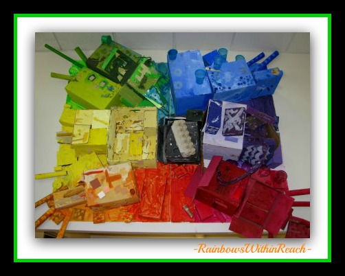 "photo of: Rainbow Bulletin Board Assemblage of ""UpCycled"" Materials (from Bulletin Board Round-UP)"