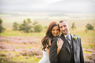 the happy couple cuddle while posing for photos